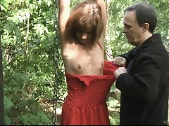 Teenage slave trussed smacked and fucked in the forest