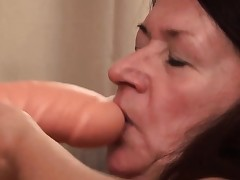 Granny likes fuckin' her big toy and show it all
