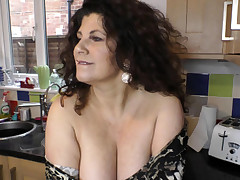 Mind-blowing busty babe dancing and showing downblouse